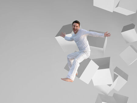 breaking free: Picture of a man sitting on a white box flying in space