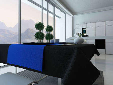 Modern kitchen interior with dining table and blue tablecloth photo