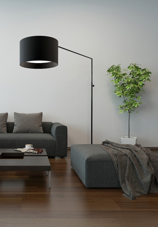 upholstered: Living room interior in shades of grey with a modern upholstered lounge suite with an ottoman and freestanding standard lamp on a parquet floor