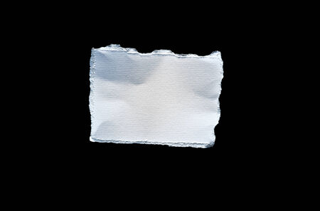 fray: Picture of scrap of white paper on black background Stock Photo