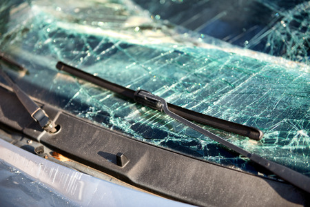 write off: Close up of the shattered windscreen and wipers of a car that has been involved in an accident
