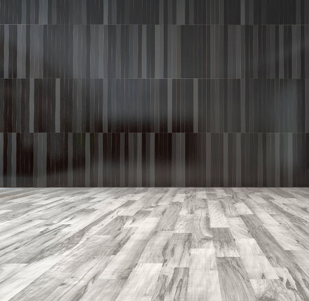 Spacious empty room with black wooden wall and white parquet floor Stock Photo