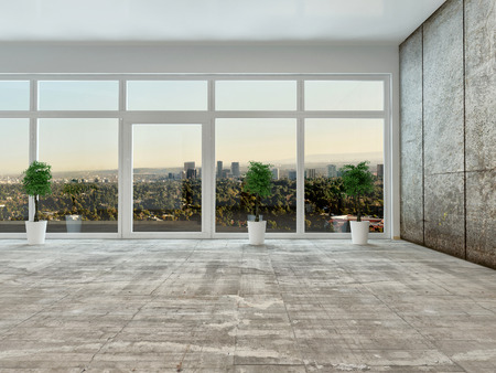 Empty living room interior with panoramic view through a floor to ceiling glass wall or window overlooking a distant town with grey decor and unfurnished except for houseplants photo