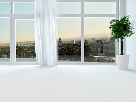 vast: View through the windows of an urban apartment at sunset to the distant town, close up of window in a white interior wall Stock Photo