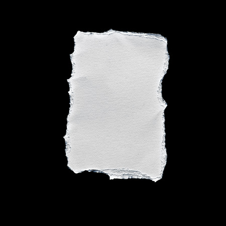Picture of scrap of white paper on black background photo