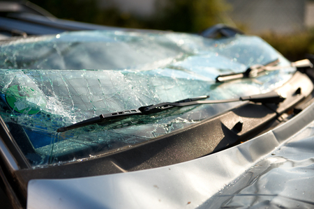 mva: Close up of the shattered windscreen and wipers of a car that has been involved in an accident