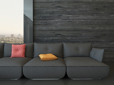 wooden furniture: Black couch against wooden wall