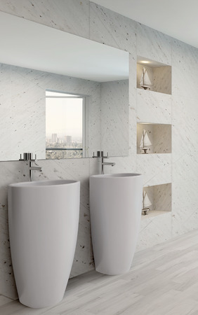 Closeup of two wash basins in a white bathroom interior