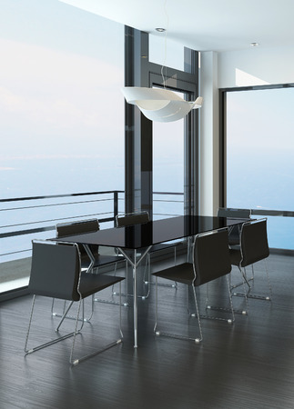 Modern black dining table standing in a modern room with huge windows photo