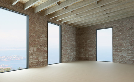 Empty room interior with brick wall and floor to ceiling windows