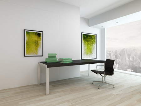 Small home office interior with paintings on wall, desk and black chair photo
