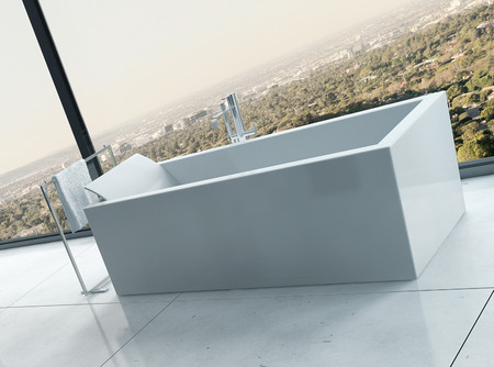 White freestanding bathtub in front of glass window with view photo