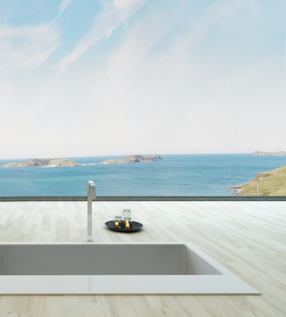 Spa style bathtub with unique seascape view photo