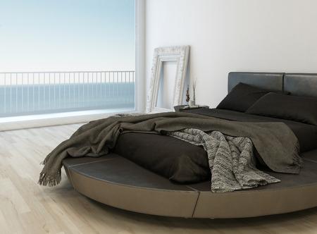 bedsheets: Letto nero con lenzuola di fronte a un'enorme finestra con vista paesaggio marino