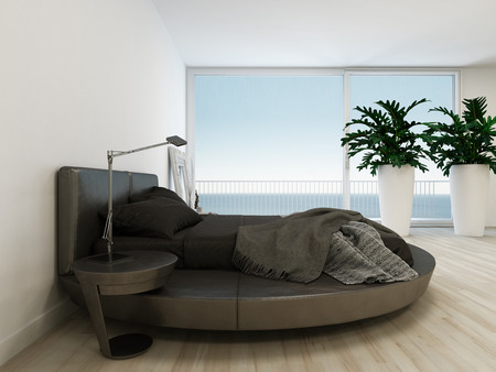 Nice bedroom interior with black king-size bed and window with seascape view photo
