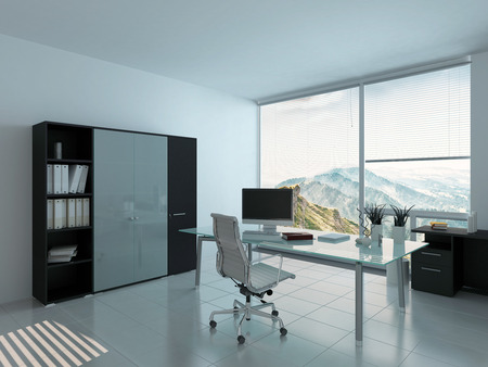 Modern office interior with desk and PC Stock Photo