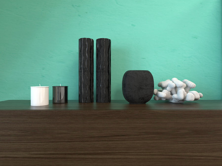Modern interior decor with vases and candles arranged on a wooden cabinet against a green painted wall with copyspace Stock Photo
