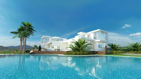 반짝이는 청록색 푸른 수영장이 내려다 보이는 야자수에 둘러싸여 아름다운 목가적 인 흰색 럭셔리 열대 빌라 스톡 콘텐츠