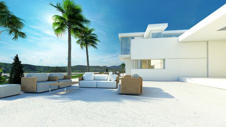 Outdoor betegeld terras woonkamer met comfortabele meubels in de schaduw van palmbomen in een moderne tropische luxe villa met witte muren