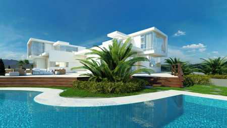 Exterior view of an angular glass walled modern upmarket tropical villa with white walls overlooking a landscaped blue swimming with pool with palm trees on a hot sunny day Stock Photo