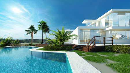 exterior wall: Luxury modern white house with angular walls and large windows overlooking a tropical landscaped garden with palm trees and curving blue swimming pool