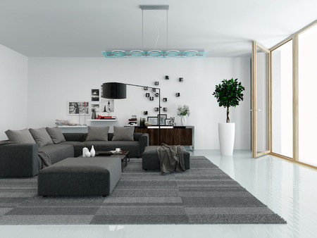 Modern living room interior with a comfortable upholstered lounge suite, houseplants and nice decorations