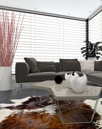 Modern lounge interior with large windows covering two walls, an animal skin on the floor, contemporary ornaments and comfortable upholstered corner unit sofa