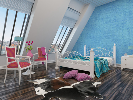Spacious modern bedroom with a wrought iron bed, sloping white walls with large windows, parquet flooring, an animal hide on the floor and dainty vintage style armchairs in red photo
