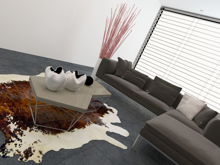 Modern living room interior with a cow hide on the floor, large windows with blinds and a comfortable modular couch in grey decor photo