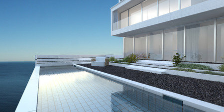 大きなガラス窓が、パティオ、晴れた青い空と海を見渡せるスイミング プールとモダンな高級ホーム