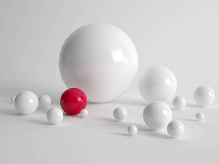 distinctive: Diversity and uniqueness concept with multiple different sized white balls and one single red ball on a grey background