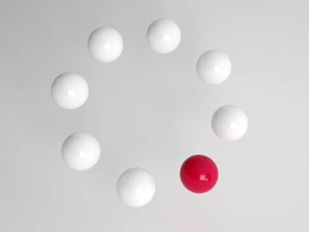 red sphere: One different red ball in a circle of white balls at an oblique angle with perspective conceptual of diversity, individuality and leadership Stock Photo