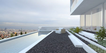 Modern luxury house with panoramic view windows overlooking a patio laid to pebbles with swimming pool and cityscape in the background photo