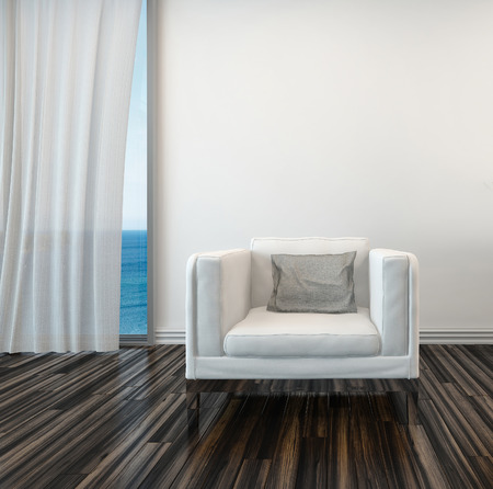 Armchair on a wooden parquet floor alongside a curtained window with a view of the sea in a living room interior photo