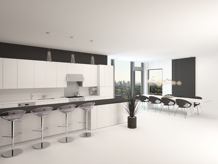 kitchenette: Modern open-plan black and white kitchen interior with a counter and bar stools and a set of armchairs grouped in front of corner view windows Stock Photo