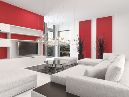 Contemporary living room interior with white decor and lounge suite with colorful vibrant red accents and a large television set with two small corner windows photo