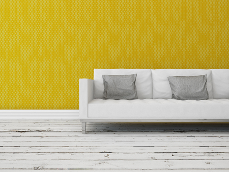 Modern sofa in front of a yellow wall on a rustic wooden floor painted white with copyspace photo