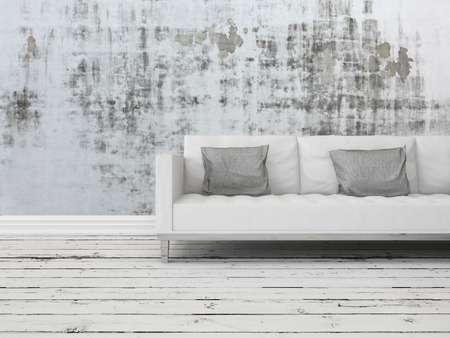 uncarpeted: Grunge rustic greyscale interior decor background with a white sofa against a patterned abstract wall with old worn wooden white painted floor boards Stock Photo