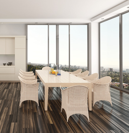 Modern dining room interior in an apartment or house with a wicker suite on a parquet floor and large view windows overlooking a city photo