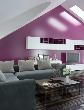 Modern apartment living room interior with a purple accent wall and sloping ceiling with skylights above a parquet floor and modern grey lounge suite with wall cabinets and television photo