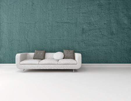 Interior decor background with a modern generic white sofa on a blue wall with a white floor with a skirting board and plenty of copy space photo