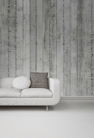 living rooms: Greyscale image of an upholstered white sofa against a concrete wall over a plain white floor with skirting board