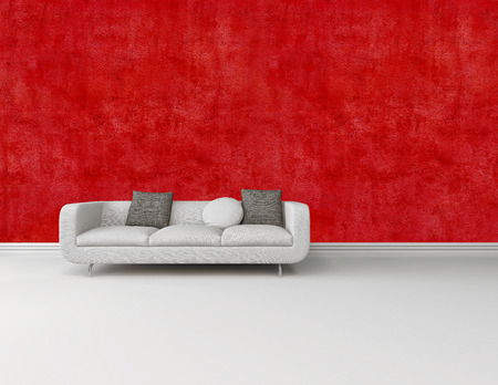 skirting: Modern white sofa with grey cushions against a bright red wall on a white floor with skirting board in an architectural and interior decor background