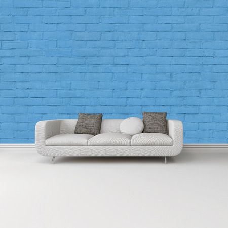 skirting: Modern white sofa with grey cushions against a bright blue wall on a white floor with skirting board in an architectural and interior decor background
