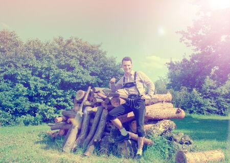lederhosen: Handsome guy in Lederhosen posing outside in nature