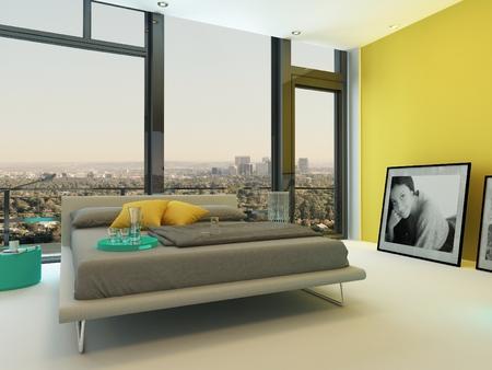 divan: Amplio colorido dormitorio interior con detalles en amarillo pared, silla turquesa y armarios y un sofá cama doble en gris delante de piso a techo con vista a la ciudad Foto de archivo