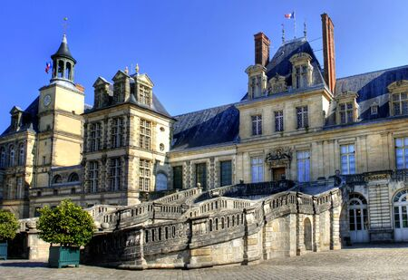 ile de france: View of the Chateau de Fontainebleau and its famous stairway, situated close to Paris it introduced the Mannerist style of architecture to France and is the largest royal chateau
