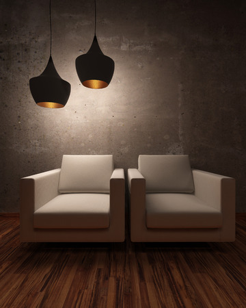 Two white chairs illuminated at night by two modern hanging lights in a shadowny room photo