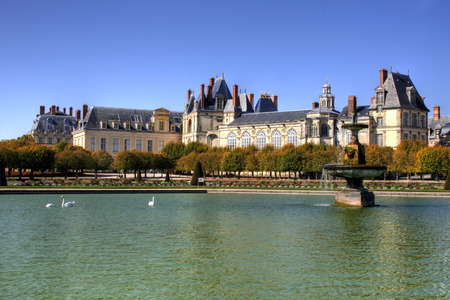 ile de france: Beautiful Park with pond of ancient Fontainebleau palace. Palace of Fontainebleau - one of the largest Medieval royal chateaux in France (55 km from Paris)