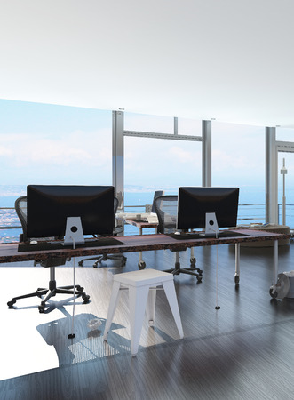 movable: Modern waterfront office overlooking the sea with several computer workstations on movable wheeled office tables in a bright airy room with a glass view window or wall Stock Photo